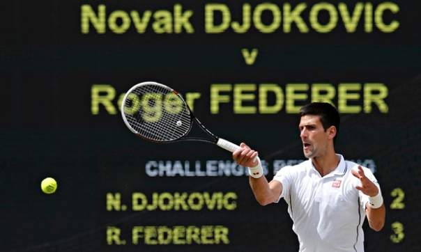 Novak Djokovic of Serbia hits a return during his men's singles final tennis match against Roger Federer. Photograph: Suzanne Plunkett/Reuters